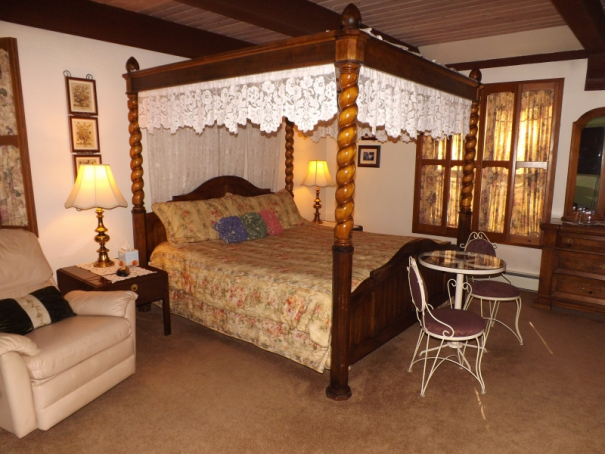 Suite 21 Bed with shades closed